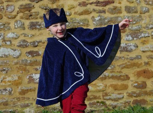 Waves and Wild Storybook Cape boy dressed as a king