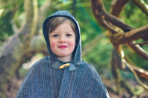 Waves and Wild Storybook Cape boy wearing grey cape with toggle fastening