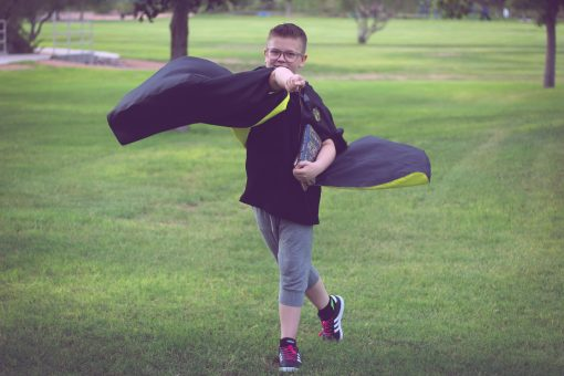 Waves and Wild Storybook Cape Hufflepuff robe casting spell