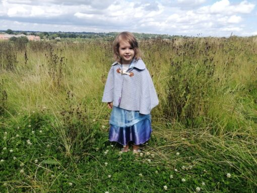 Waves and Wild Storybook Cape girl wearing grey cape