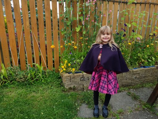 Waves and Wild Storybook Cape girl wearing pink and purple