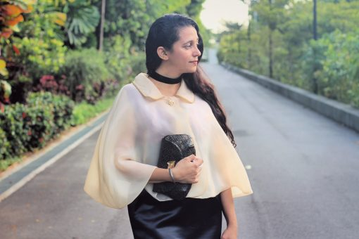 Waves and Wild Storybook Cape sheer cape with clutch bag